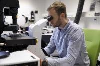 Benedikt Buchmann at the microscope