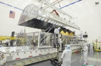 Engineers Open the Interior Tent Frame of the Space Telescope Transporter
