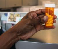 Hand Holding Vitamin D Pills