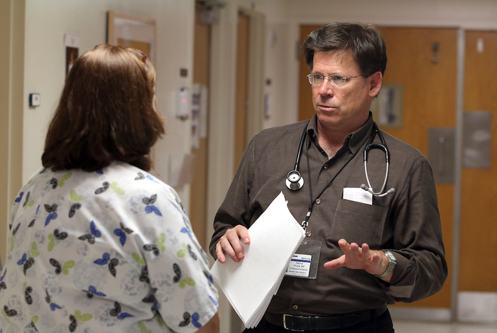 Medical University of South Carolina pulmonologist Dr. Patrick Flume speaks with a colleague