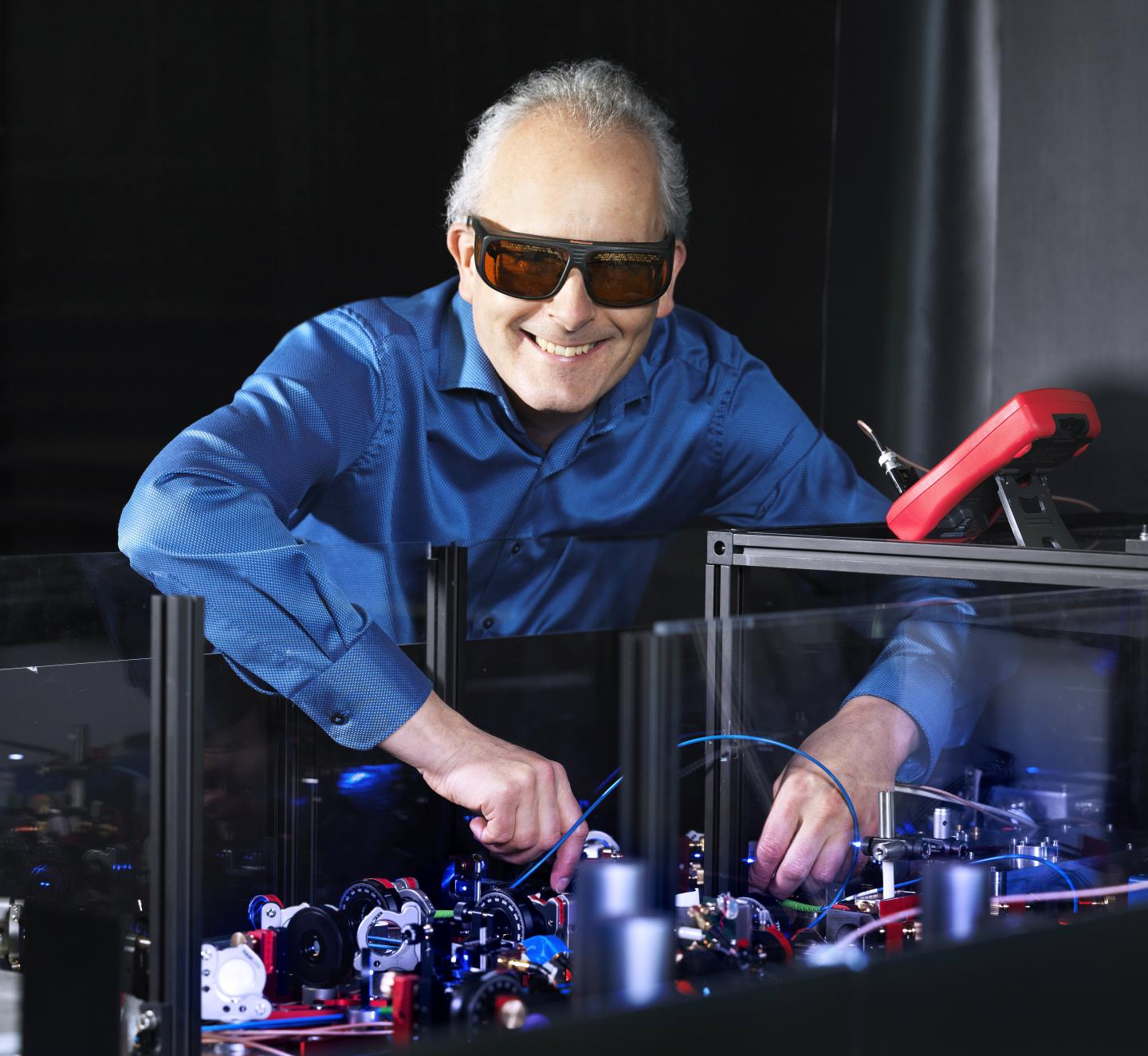 Prof. Dr. Piet Schmidt at work on the laser table.