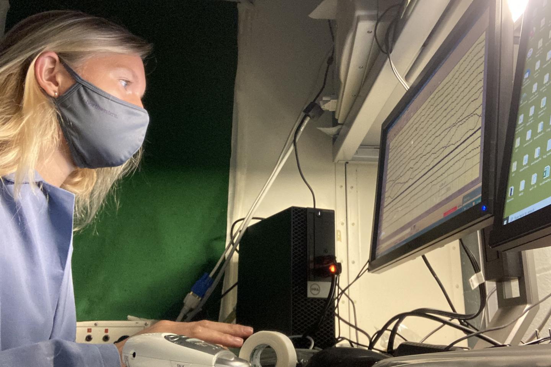 Researcher watching brain signals