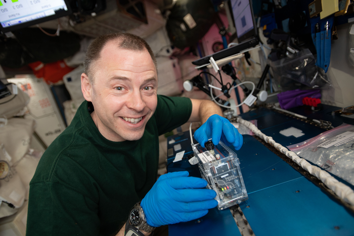 NASA astronaut Nick Hague runs an analysis with the miniPCR hardware for Genes in Space-6 during Expedition 59.