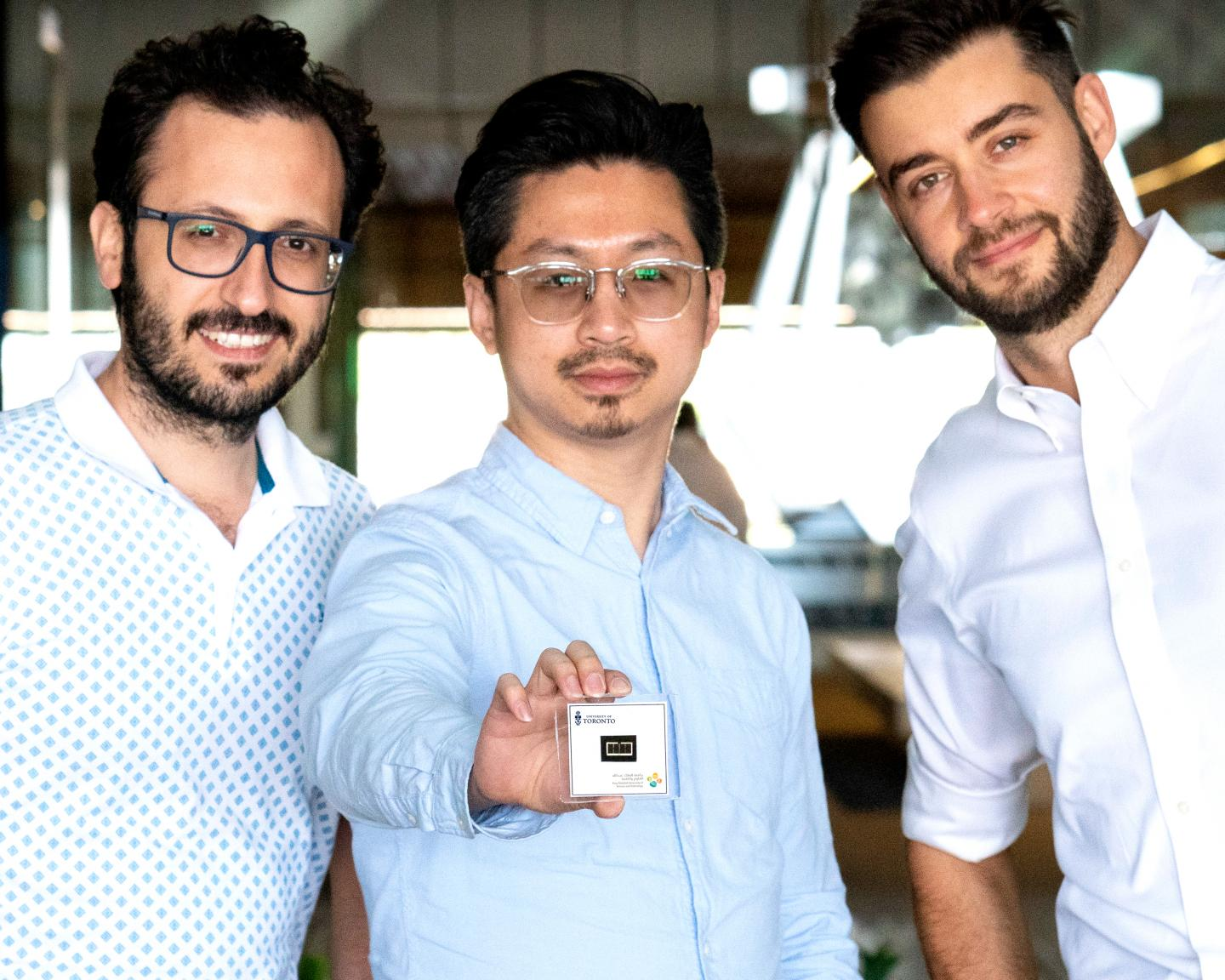 Researchers with Tandem Solar Cell