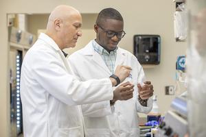 Dr. Ogretmen and Alhaji Janneh from the Medical University of South Carolina