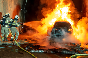Firefighters extinguish vehicle fire