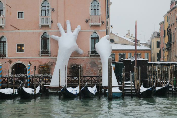 Giant Hands, called Support, in a rare snowy event in a floating city of Venice