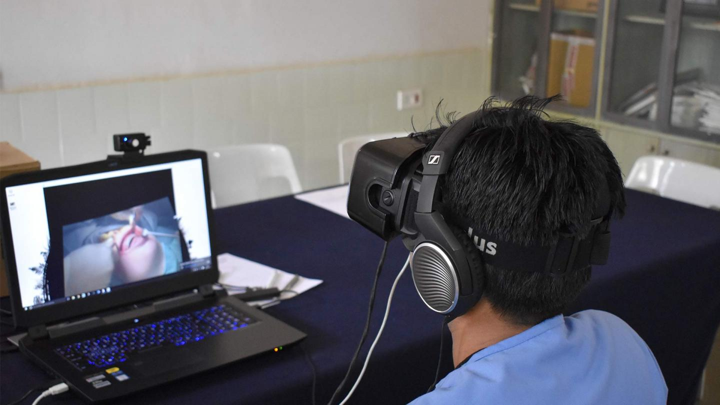 A dental student with VR headset