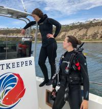Scientists on boat for seagrass field work