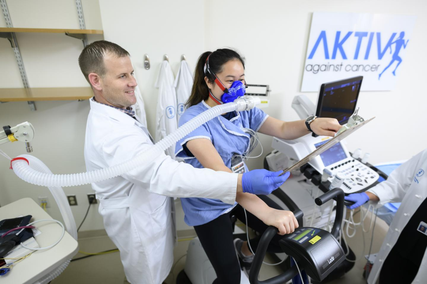 Physiologist Conducts Cardiopulmonary Exercise Test on Patient