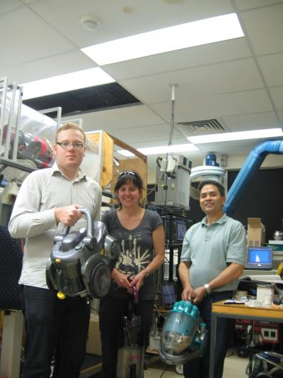 Researchers Holding Vacuums