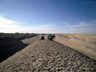 People on Yardang in Qaidam Basin, Central Asia