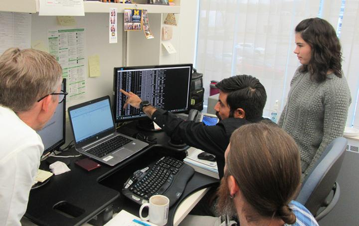 Karan Bedi explains the complex data analysis pipeline. Professor Ljungman is on the left