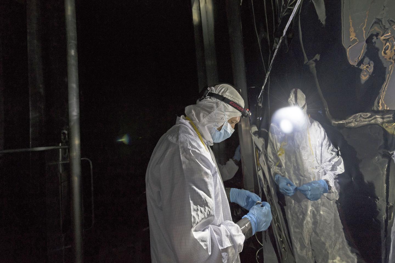 Technician Checks Helium Shroud Around Webb