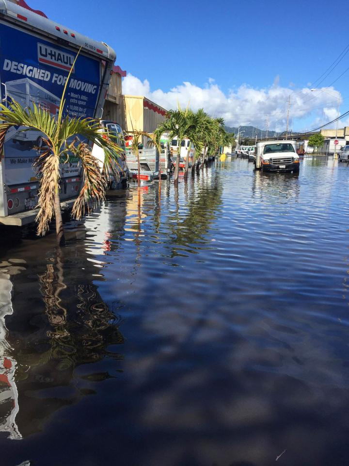Moving vans in flooded area