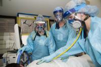 Nurses wearing elastomeric masks