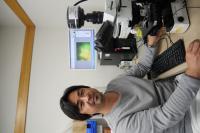 Associate Professor Yohey Suzuki at the Microscope with Rock Sample