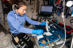 NASA astronaut Christina Koch works on the Genes in Space-6 investigation