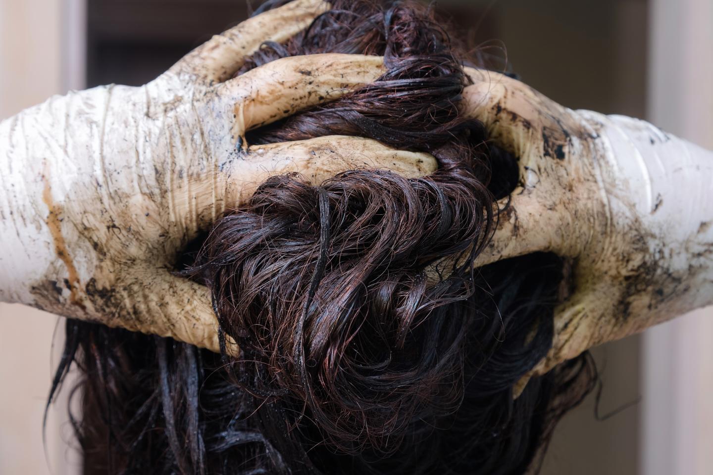 Woman Using Permanent Hair Dye