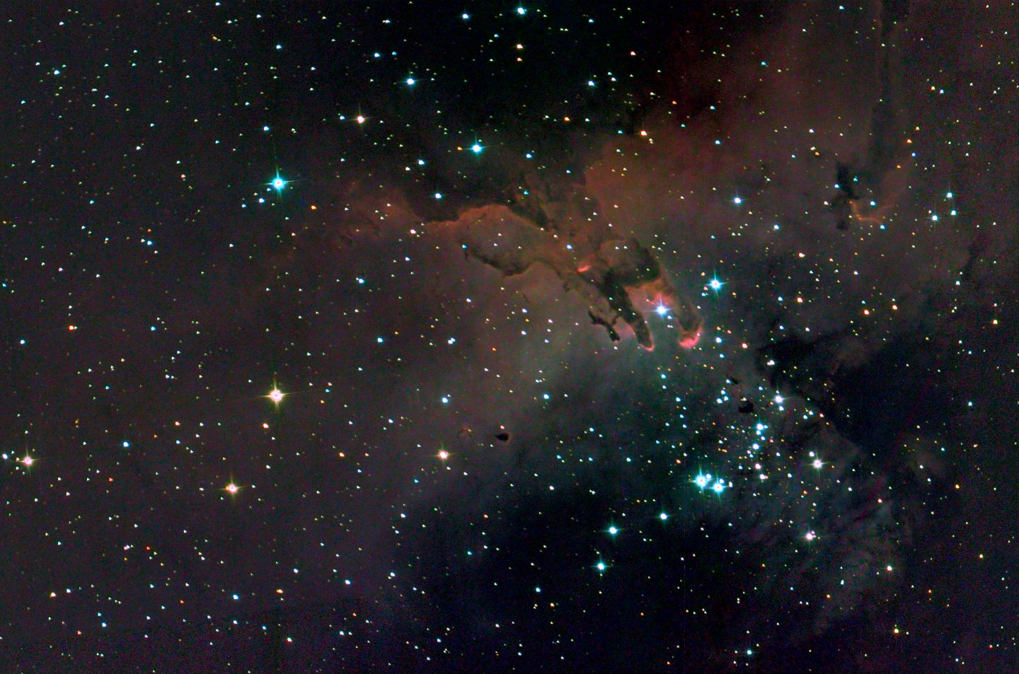 A SuperBIT optical and ultraviolet composite image of the 'Pillars of Creation'