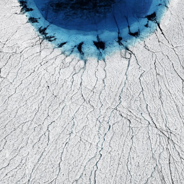 Melting of Greenland Ice Sheet Forms Lakes that Drain in Summer