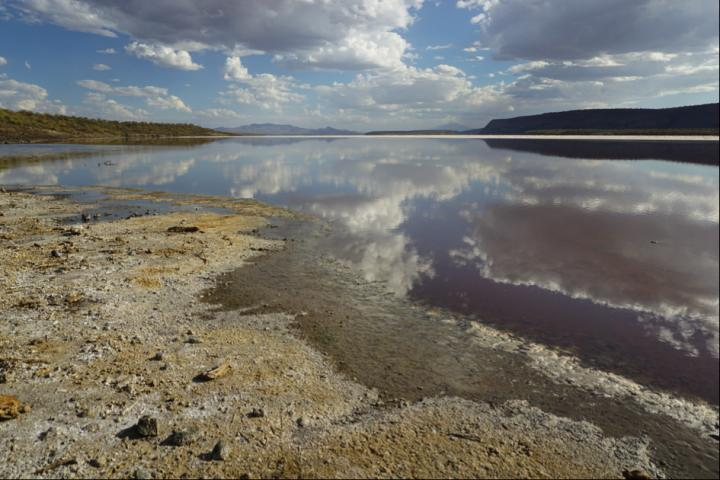 Clouds reflecting in lake Magadi, Kenya, located in the Eastern Branch of the East African Rift System