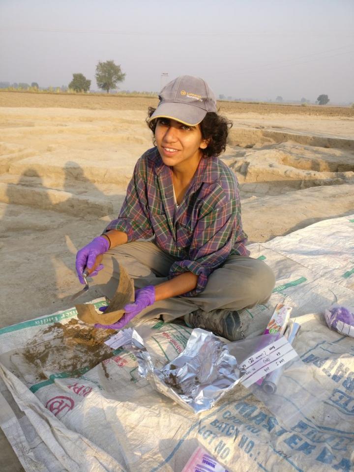 Lead author Akshyeta Suryanarayan sampling pottery for residue analysis in the field.