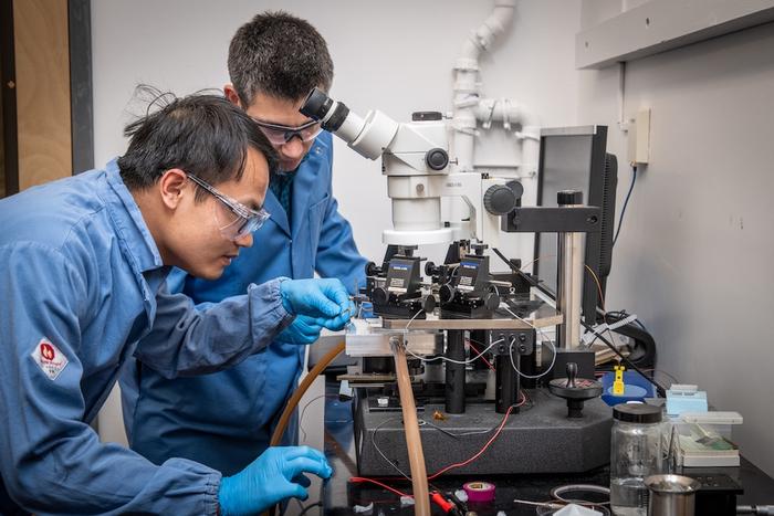 Berkeley Lab researchers Yuqiang Zhen and Sean Lubner