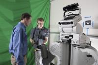 Charlie Kemp and Zackory Erickson Working with Robot