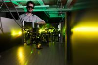 Felix Thouin in Carlos Silva's Georgia Tech Lab with Visible-Range Laser