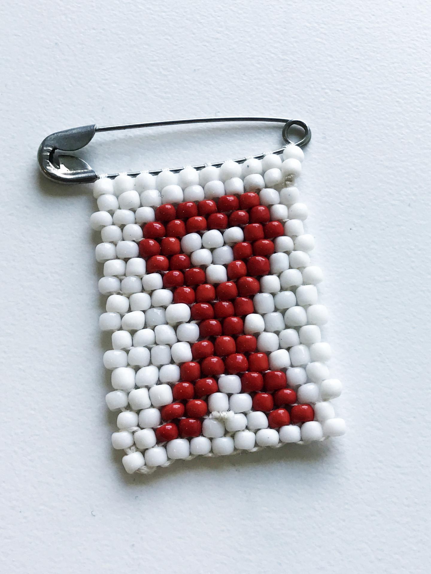 An HIV Awareness Ribbon Pin