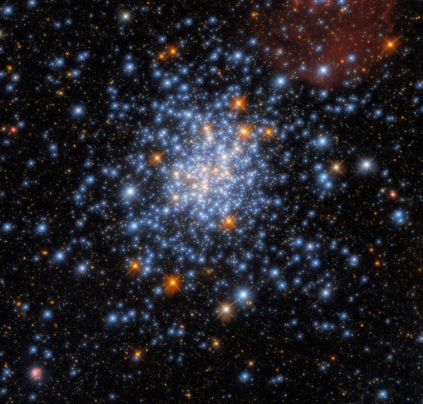 Hubble sees a cluster of red, white, and blue