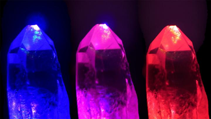 Three crystals - blue, pink, red - on black background