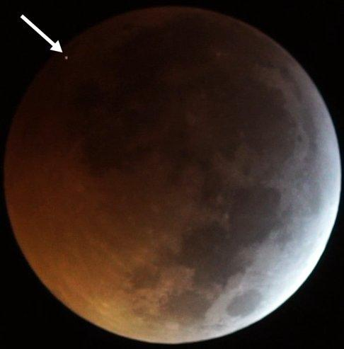 the Flash from the Impact of the Meteorite on the Eclipsed Moon