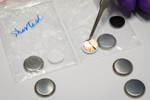 The NTU anti-short layer (upper right held by tweezer) stops short circuits from happening in li-ion batteries.