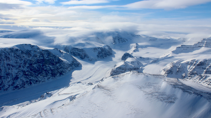 Ice capped and snow-covered mountains of coastal west Greenland. (Apr. 2015)