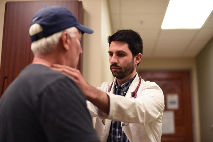 Brian Hess, M.D., with a patient