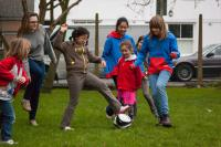 Girls from Rainbows, Brownies, Guides and Senior Section Play Football