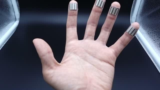 Four fingertips with biofuel cells