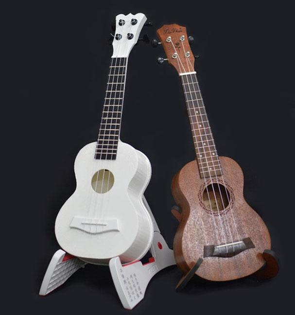 Comparison of a 3D-Printed Ukulele (Left) and a Standard Wooden Instrument (Right)