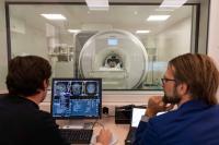 Dr Philip Koch and Professor Friedhelm Hummel performing an MRI.