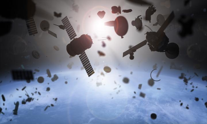 A Deorbit Kit for Satellites Based on Low Work-Function Tethers