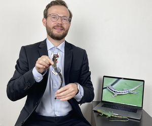 Ardian Jusufi with a soft gecko-inspired robot
