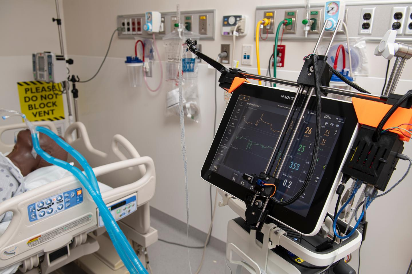 Robotic Device Controls Ventilator From Outside Room