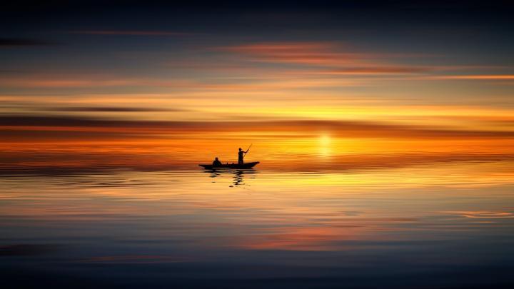Small Craft on Still, Sunset Ocean