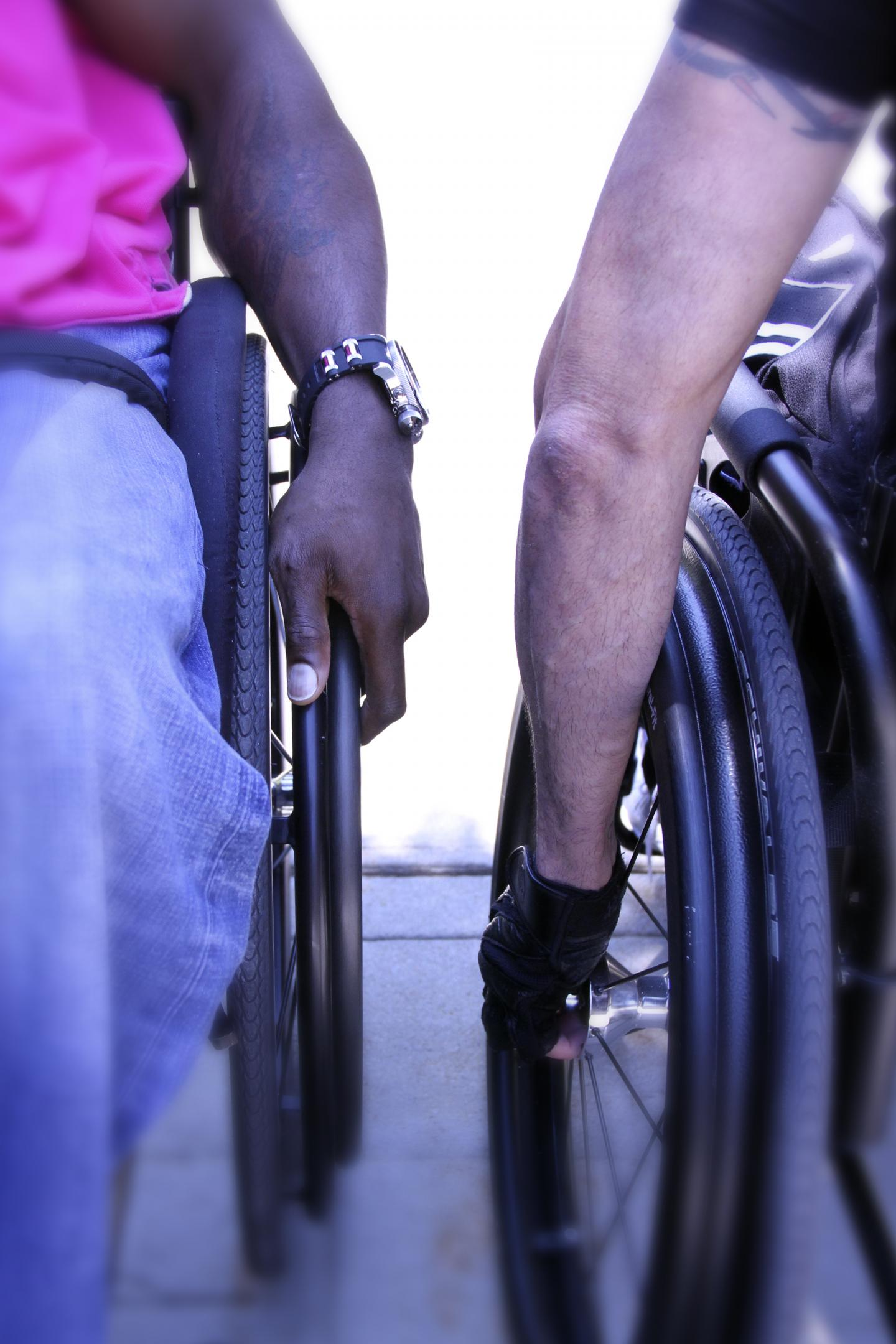 A pair of manual wheelchair users at Kessler Foundation.