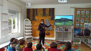 Researcher talking at a school