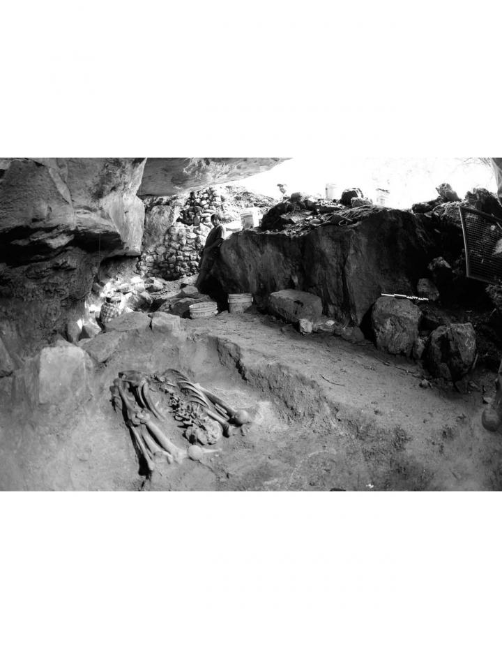 Human deposit in rock shelter attached to Northern Acropolis exposed in situ