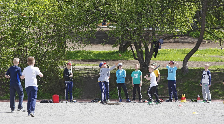 Children Playing Finnish Baseball
