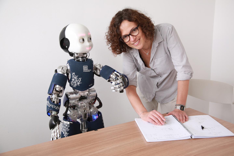 Agnieszka Wykowska interacting with the humanoid robot iCub